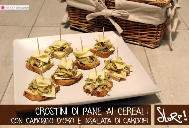 Crostini di pane ai cereali con Camoscio d'Oro e insalata di carciofi crudi