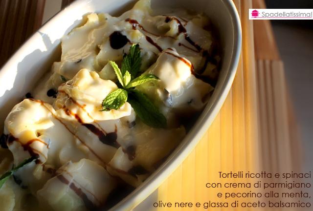 Tortelli ricotta e spinaci con crema di parmigiano e pecorino alla menta, olive nere e glassa di aceto balsamico